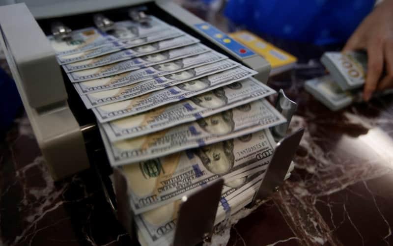 Dollar Advances - Reuters/YC