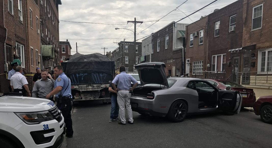 Transit Police & Philadelphia Police at the scene of where the vehicle was recovered at the intersection of 8th St & Mercy St., South Philadelphia (PHOTO: YC.NEWS/NIK HATZIEFSTATHIOU/ERIC NORTON)