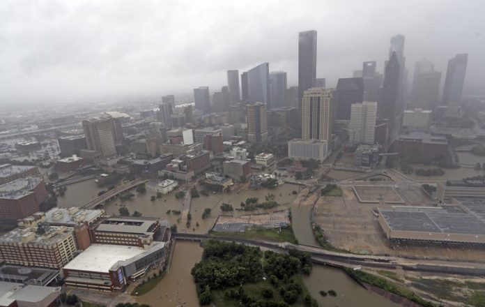 Highays around downtown Houston are empty as floodwaters from Tropical Storm Harvey overflow from the bayous around the city Tuesday, Aug. 29, 2017, in Houston. (AP Photo/David J. Phillip)