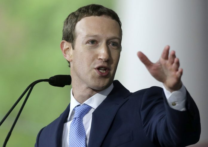 """FILE – In this May 25, 2017, file photo, Facebook CEO Mark Zuckerberg delivers the commencement address at Harvard University in Cambridge, Mass. Zuckerberg says his """"personal challenge"""" for 2018 is to fix Facebook. Zuckerberg wrote in a post Thursday, Jan. 4, 2018, that he now wants to focus on protecting Facebook users from abuse, defending against interference by nation-states and """"making sure that time spent on Facebook is time well spent."""" (AP Photo/Steven Senne, File)"""