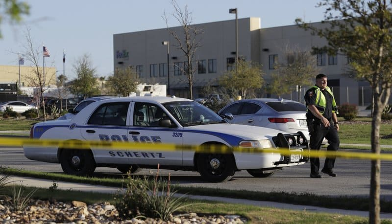 A police officer stops a vehicle at a check point in front of a FedEx distribution center where a package exploded, Tuesday, March 20, 2018, in Schertz, Texas. Authorities believe the package bomb is linked to the recent string of Austin bombings. (AP Photo/Eric Gay)