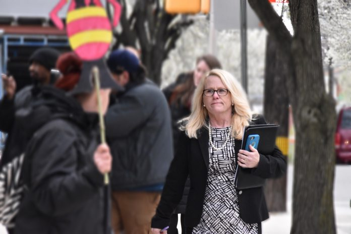 District Attorney Spokeswoman Kate Delano exiting courthouse following Cosby camp to a press conference at the conclusion of day 6 of the trial. (YC.NEWS)