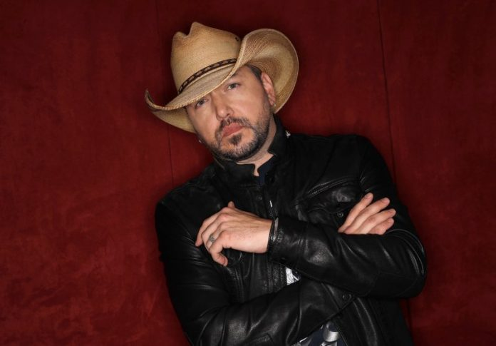FILE - In this March 19, 2018, file photo, Jason Aldean poses in Nashville, Tenn. Aldean, Carrie Underwood and Florida Georgia Line are the leading nominees for the CMT Music Awards with four each. Little Big Town, who are nominated for three awards, will host the show, which airs on June 6 at 8 p.m. Eastern on CMT. (AP Photo/Mark Humphrey, File)